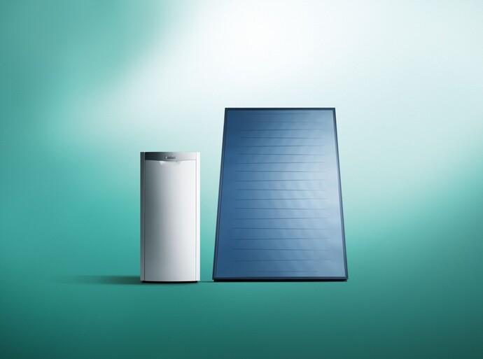 Caldera de gasóleo icoVIT y panel solar auroTHERM sobre fondo verde